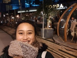 A girl in front of Coppa Club Tower Bridge Restaurant