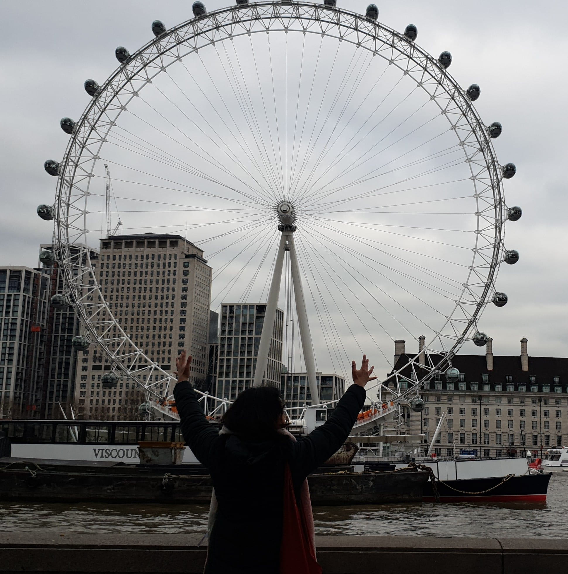 A girl in front of the London Eye