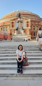A lady in front of the Royal Albert Hall, London